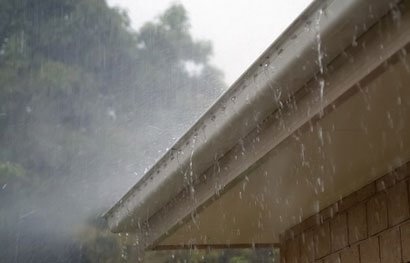 brunswick ohio roofing picture of a gutter and a lot of rain hitting a roof on a home
