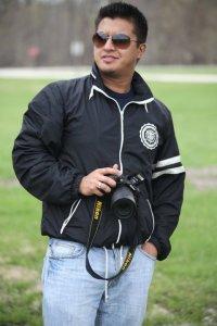 Bipin Tamrakar Holding Camera