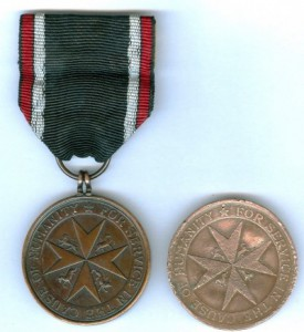 Daniel McCarthy's Lifesaving Medal of the Order of St John, shown with a modern equivalent