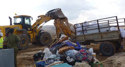 Demolition of a residential tent and a shack in Susiya. Photo: Nasser Nawaj'ah, B'Tselem,  24 Nov. 2011.