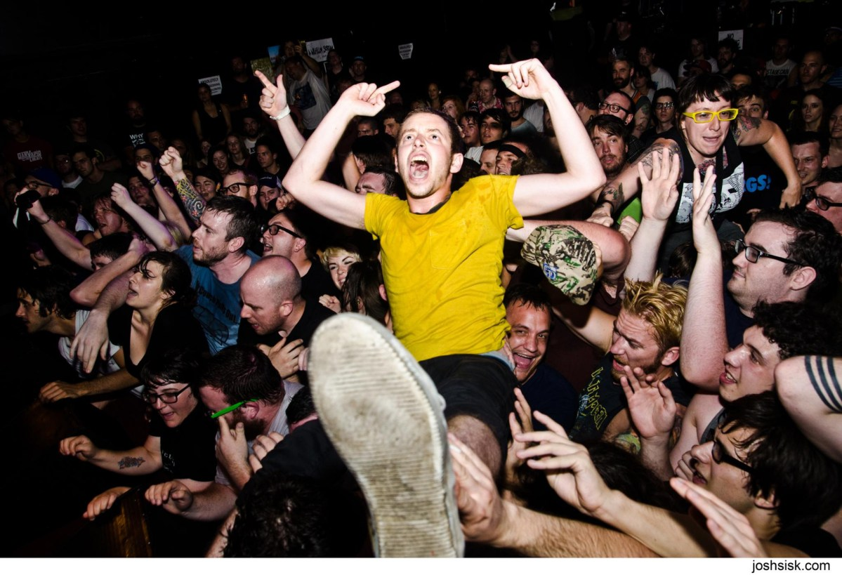 Crowd surfing. Photograph by Josh Sisk.