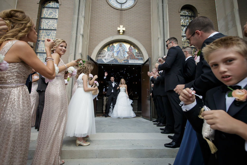 Monique Lhuillier Bridal Gown   Orthodox Ceremony   Church Exit   Chicago Wedding   Cafe Brauer Wedding   Bubbly Moments