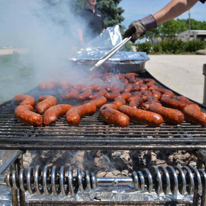 hotdogs on a grill