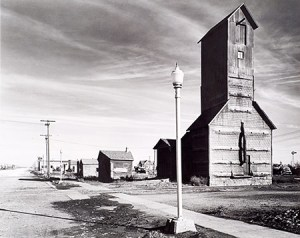 """Grain Elevator and Lamp Post, Nebraska, 1940."" Photo by Wright Morris. (Image credit: Museum of Nebraska Art)."
