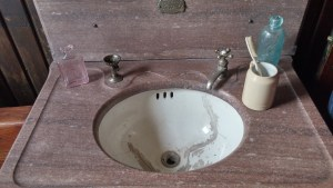 Sink with Dunbar's cup and toothbrush.