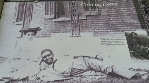 Dunbar and unidentified friend resting in yard outside of what is now the Paul Laurence Dunbar State Memorial.