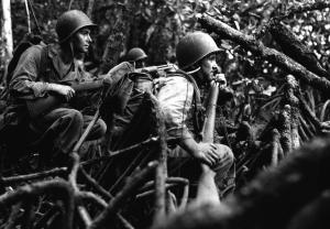 American soldiers move through jungle during the Solomon Islands fighting: September 13, 1943.