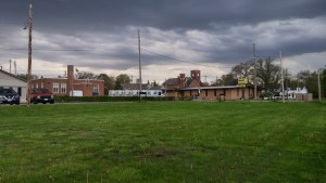This grassy area was where the railroad depot in Anderson's time was located (author's photo).