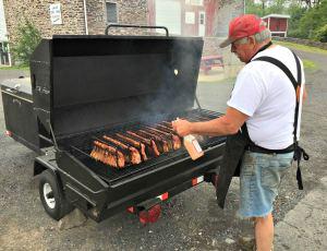 Oink Johnson's BBQ_Jack making ribs