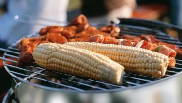 Corncobs and meat on grill; MSClipArt