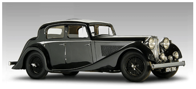 An SS Jaguar 2 1/2 Litre Sedan on a grey background