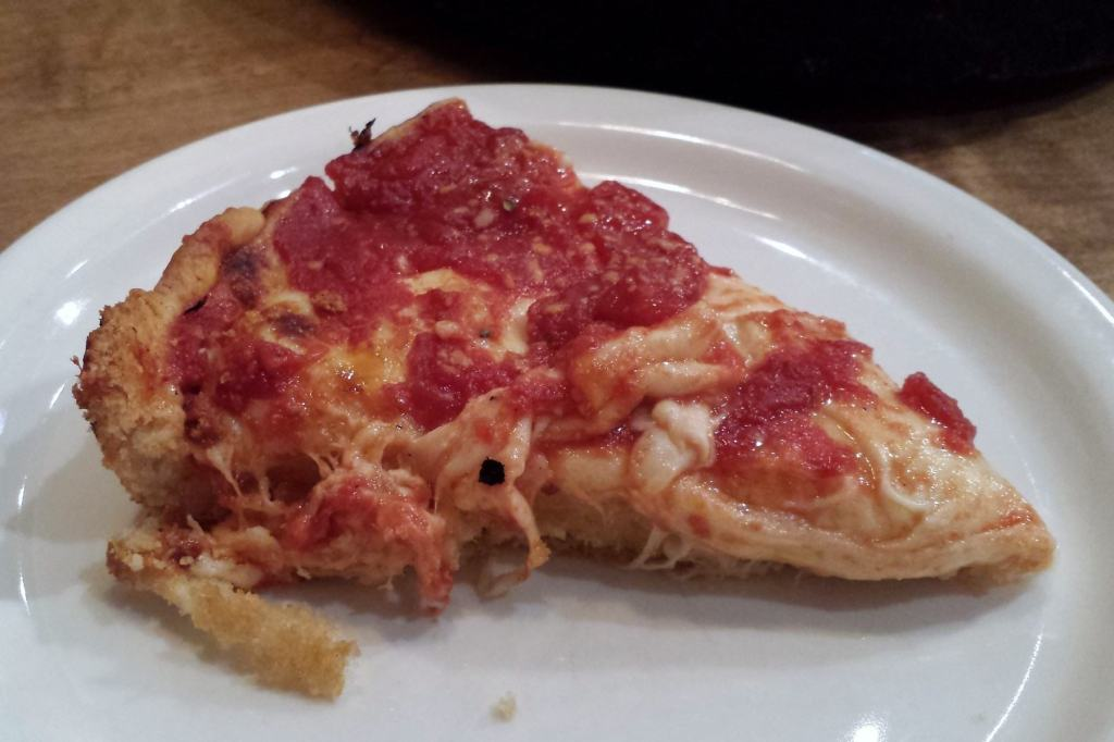 slice of cheese pizza at the Gold Coast location of Lou Malnati's