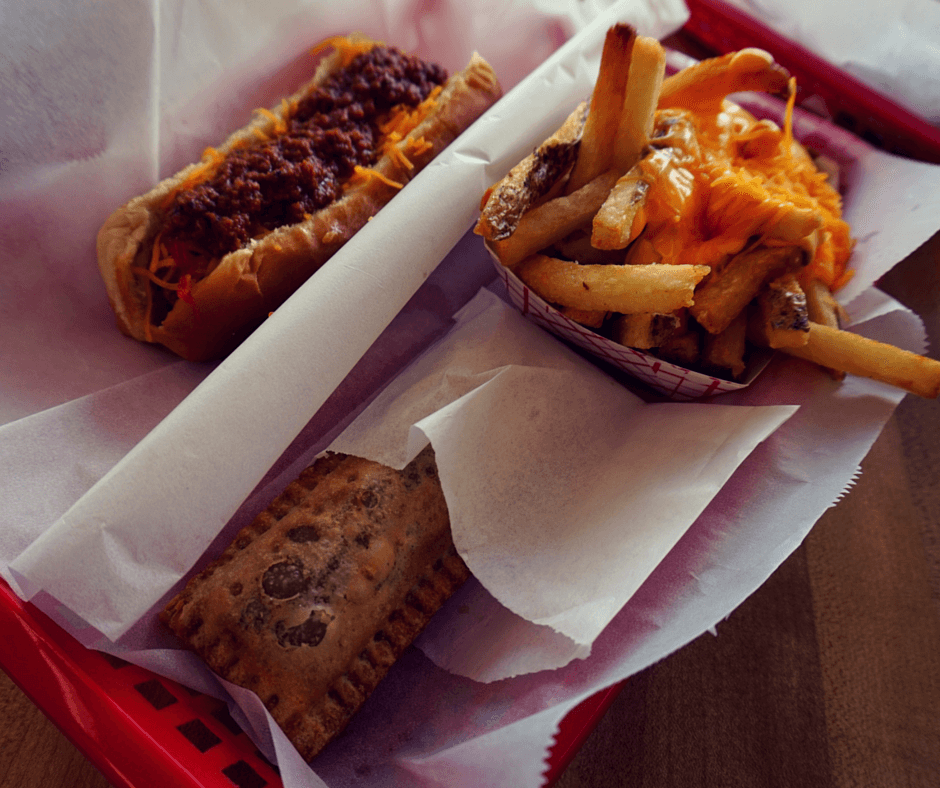 Big Dog with chili and cheese and a side of cheese fries and small apple pie