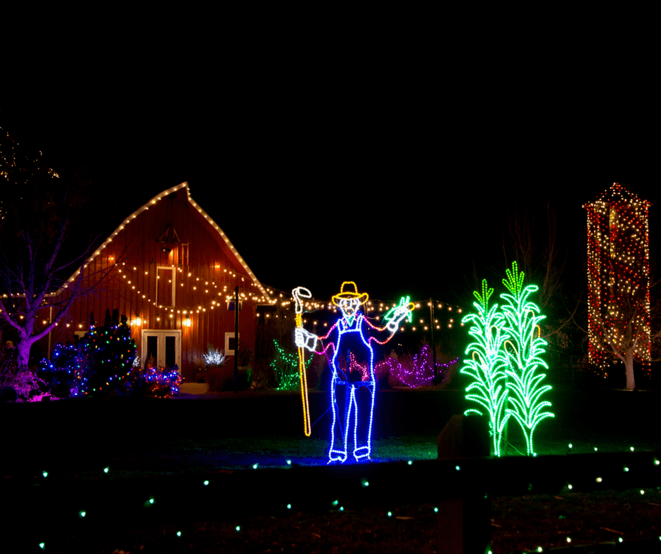 A scarecrow, house with lights at Chatfield Farms