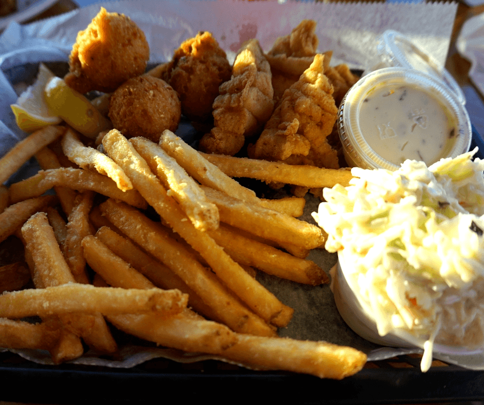 Basket of fish, french fries, hushpuppies, and coleslaw from Riverside Crab House