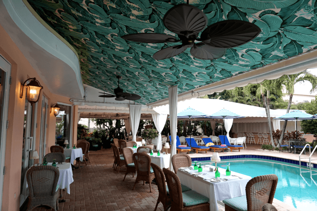 Poolside tables at the Colony Hotel