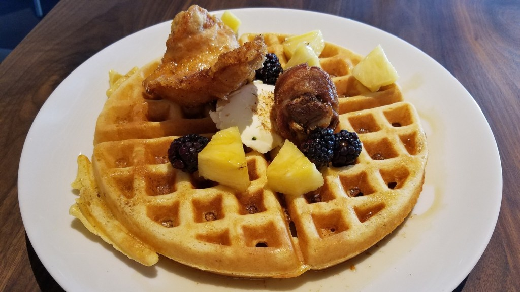 Chicken and waffles at Concourse Restaurant Moderne