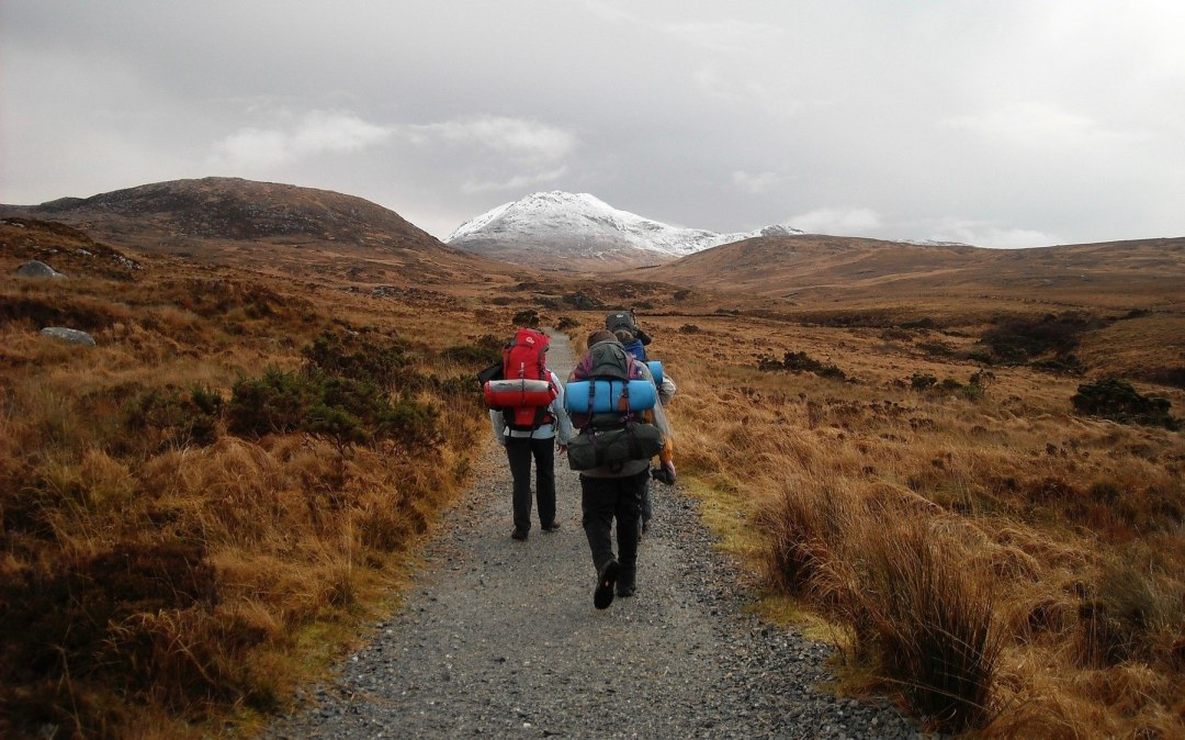Three backpackers on a trail