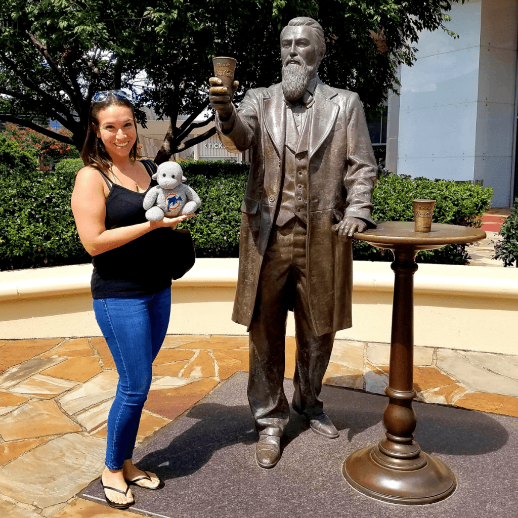 Standing with Dr. John S. Pemberton, the creator of Coca-Cola