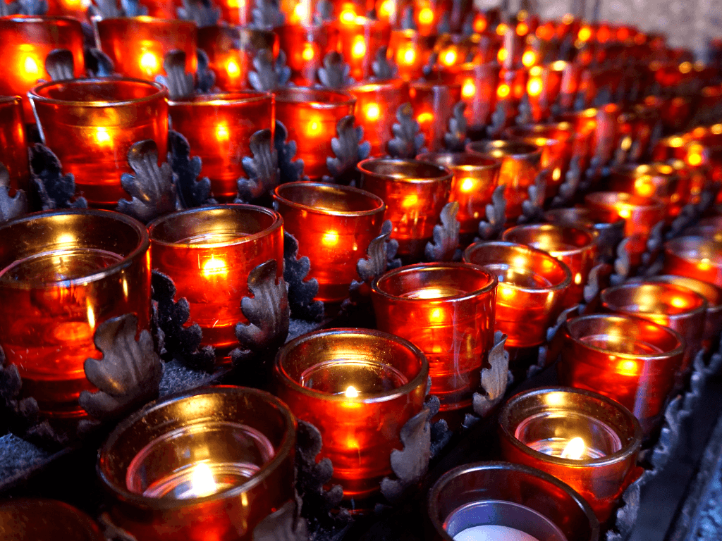 Prayer candles inside the Chapel of the Holy Cross