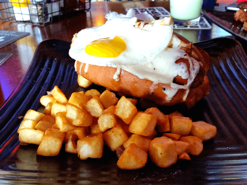 Good Morning Dog - Bacon wrapped hot dog topped with a fried egg, American cheese and home fries from Island Dogs in Key West