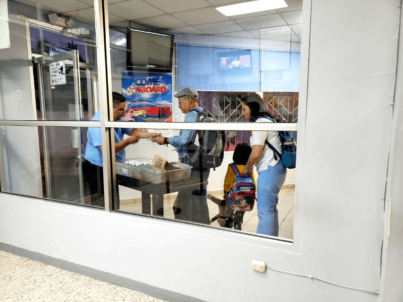 Passengers getting snacks before they board in Tegucigalpa Honduras