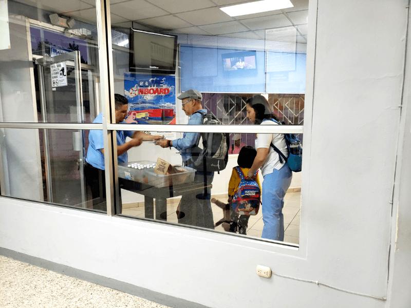 Passengers getting snacks before they board in Tegucigalpa Honduras