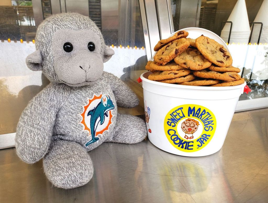 Buddy with a bucket of cookies from Sweet Martha's Cookie Jar
