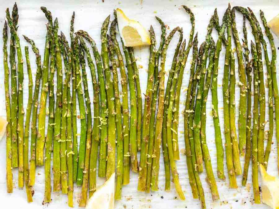 Close up overhead shot of lemon garlic roasted asparagus on the sheet pan
