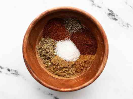 Taco seasoning spices in a small wooden bowl