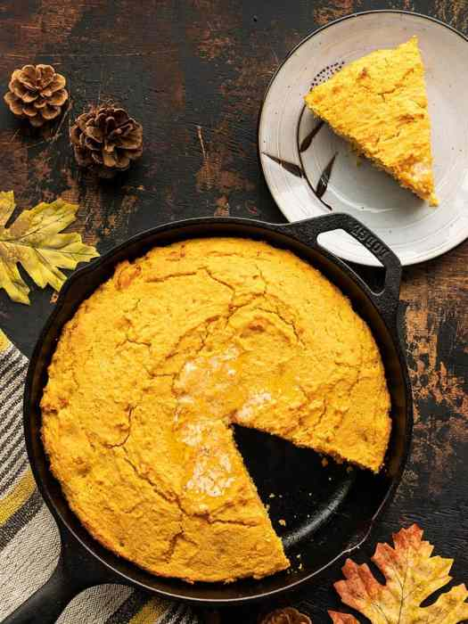 Sweet potato cornbread with one sliced removed and on a plate on the side