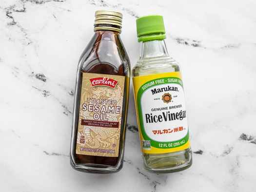 Bottle of toasted sesame oil and a bottle of rice vinegar