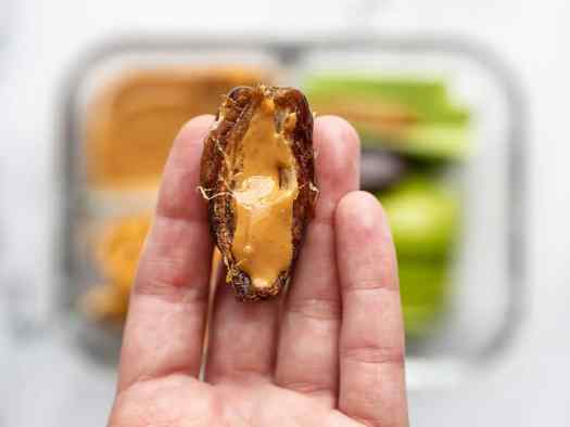 Date half with peanut butter