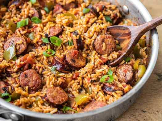 Side view of a skillet full of Cajun Sausage and Rice