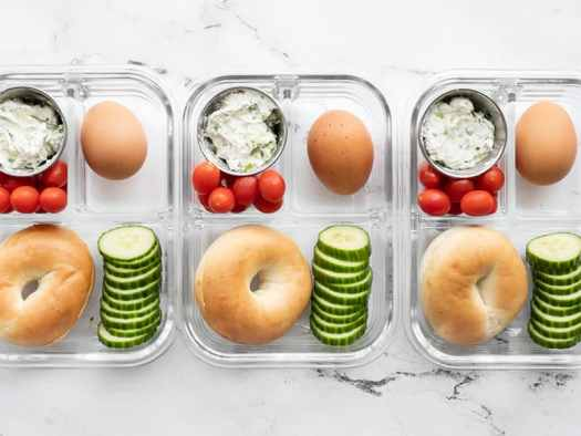 Three bagel lunch boxes lined up in a row