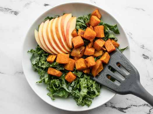 kale, apple, and sweet potato in a bowl