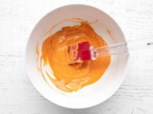 mayonnaise and gochujang mixed together in a bowl