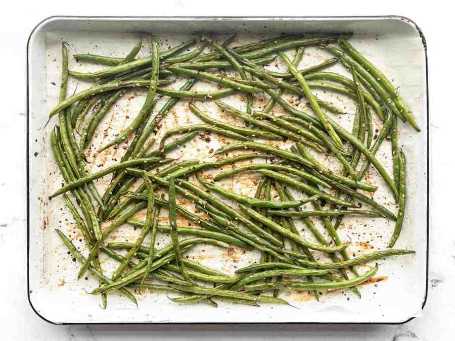 Finished sesame roasted green beans on the baking sheet