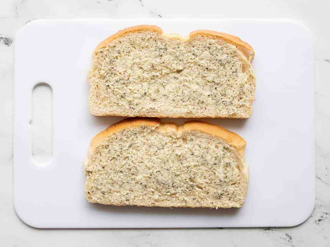 Buttered bread on a cutting board
