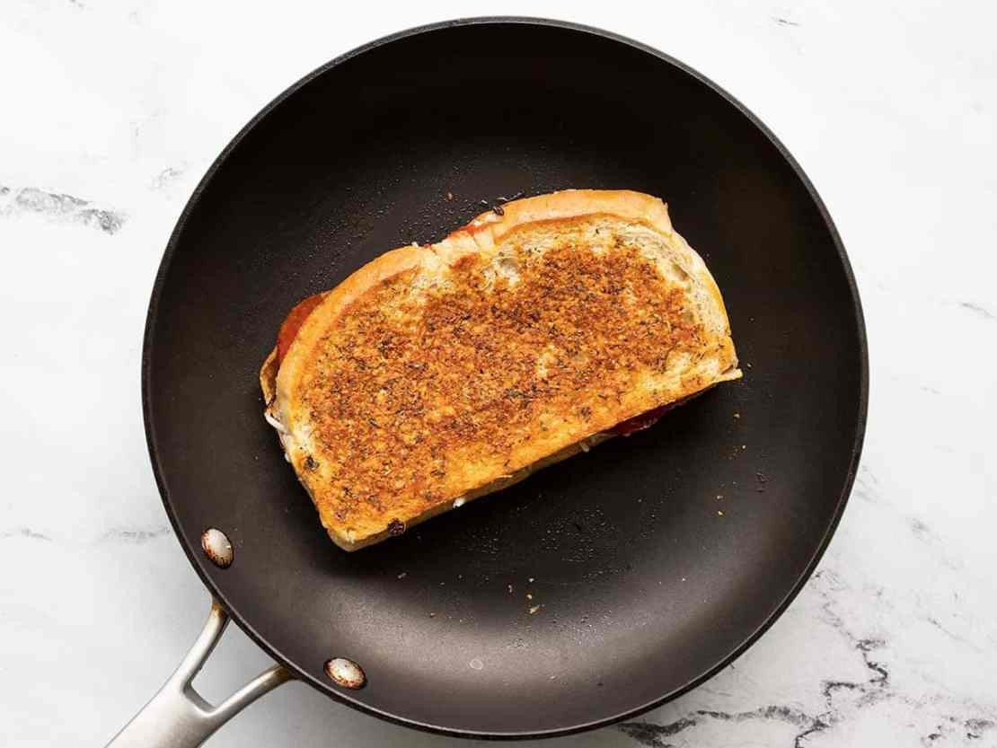 pizza melt cooking in a skillet
