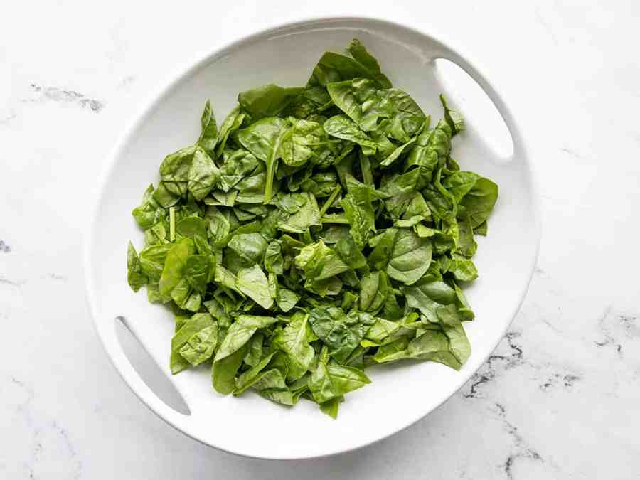 Chopped spinach in a serving bowl