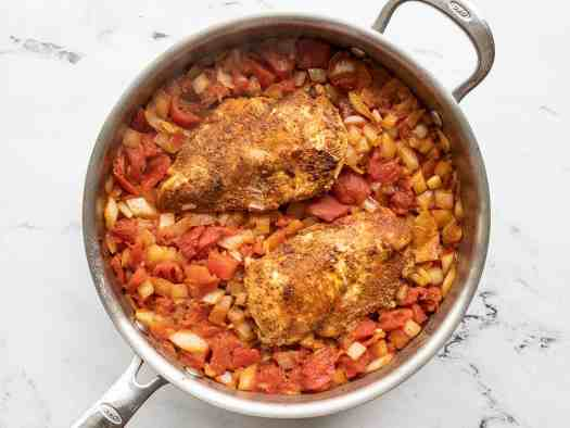 Cooked chicken and rice in the skillet