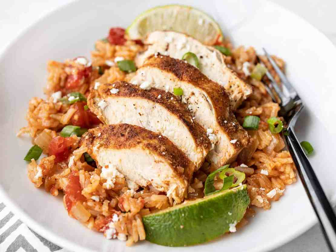 Side view of chipotle lime chicken and rice in a bowl
