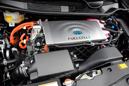 Today's hydrogen fuel cells are the size of a typical V6 engine. The cell creates a chemical reaction that turns compressed hydrogen (from a storage tank) and oxygen (from the air) into electricity, water and heat.