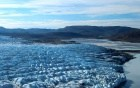 an expanse of ice meeting water