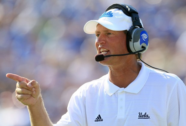 Head Coach Rick Neuheisel of the ...