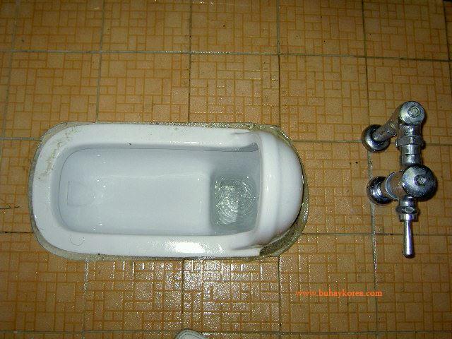 A Korean style squat toilet