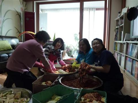 My MIL and SILs making kimchi for the winter season...