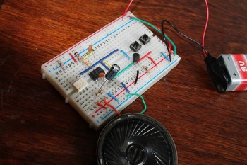Latch-up circuit using 555 and opto-coupler