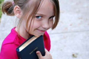 girl with Bible child